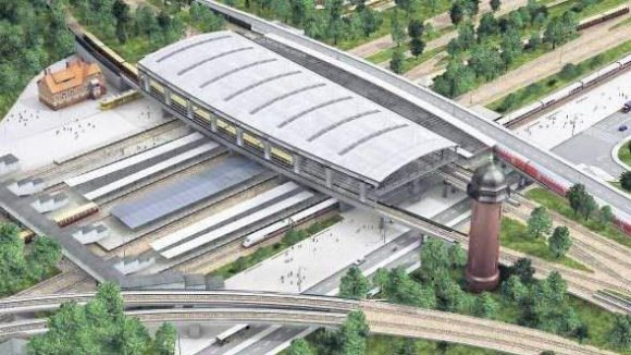"""Irgendwann soll der Bahnhof Ostkreuz inklusive der neuen Vorplätze so aussehen. Auch zu erkennen: Eines der denkmalgeschützten Beamtenwohnhäuser, die """"Planstraße 4"""" mit Straßenbahn, Berlins größte Jugendherberge und links die historische Fußgängerbrücke."""