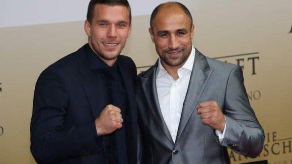 ... sowie Lukas Podolski und Freundin ... ähm Verzeihung: Boxer-Kumpel Arthur Abraham.