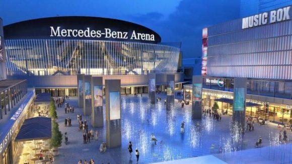 So stellen sich die Planer das Viertel an der Arena am Abend vor. In der Mitte ein Wasserspiel.