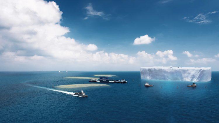 Boote um einen Eisberg im Meer, der abgebaut wird.