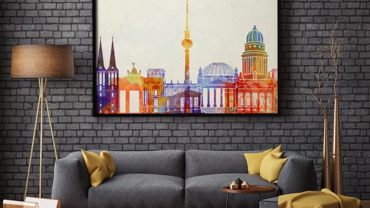 Modernes und schlichtes Wohnzimmer mit einem bunten und verspielten Poster der Berliner Skyline von Myloview.de