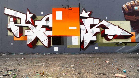 Graffiti von Raws an einer Wand