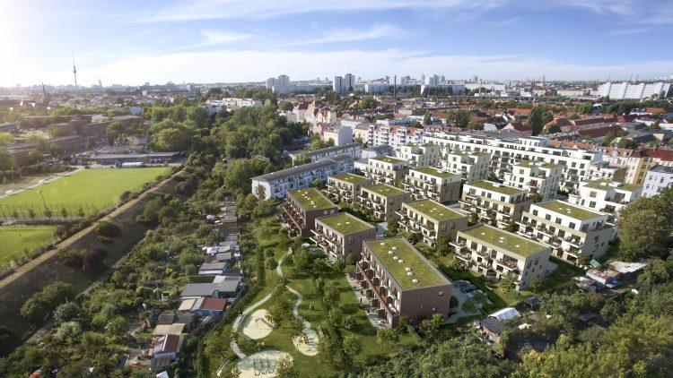 Bild aus der Vogelperspektive vom Berliner Stadtpanorama und dem Wohnpark Lichtenhain mit begrünten Dächern.