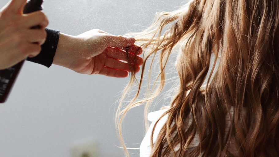 woman in white shirt holding hair