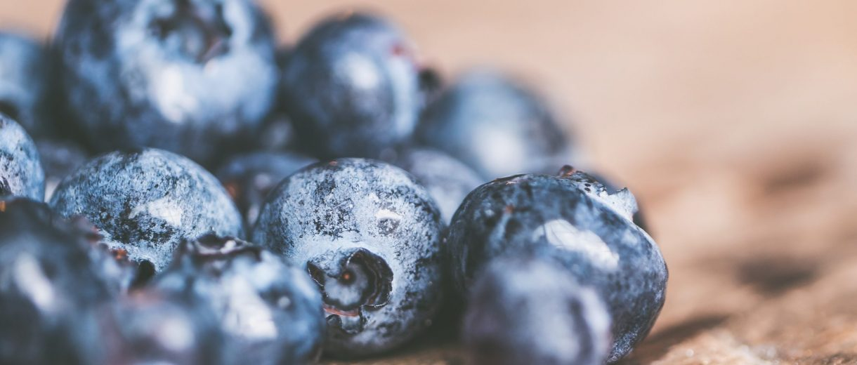 selective focus photo of blueberries