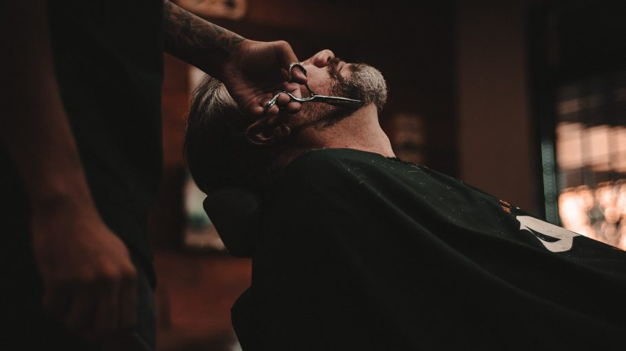 man sitting on barber's chair