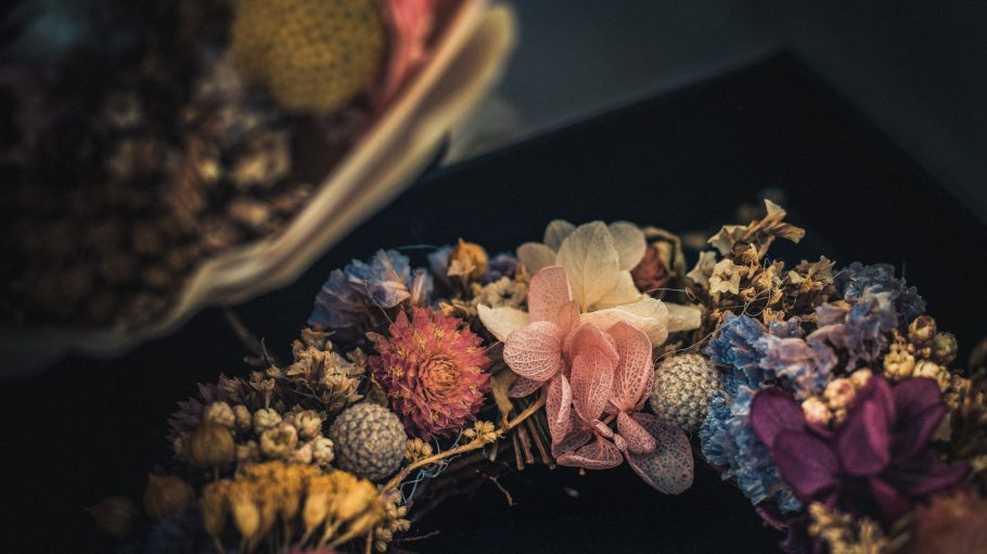 photo of flower wreath on black surface
