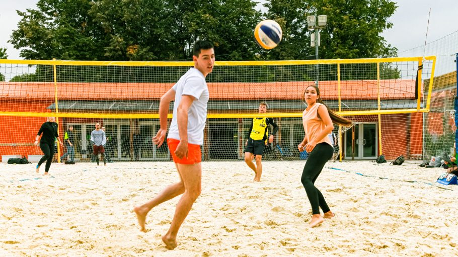 group of people playing volleyball
