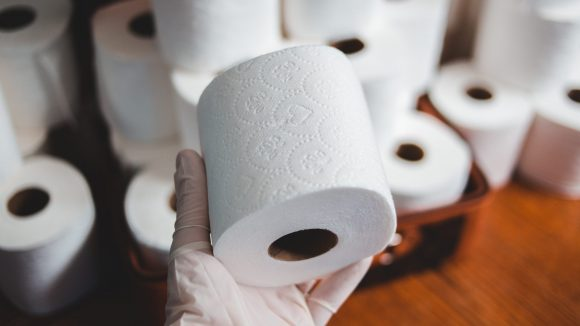 white tissue paper roll on brown wooden table