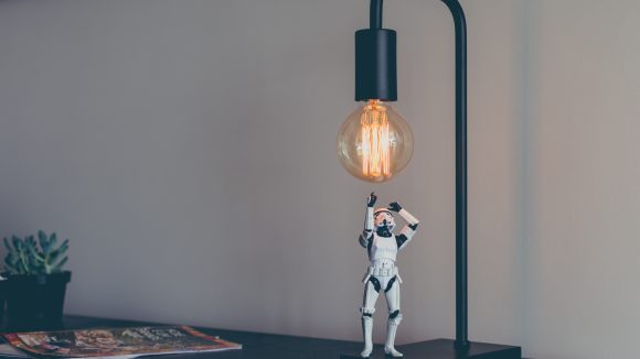 Storm Trooper vinyl figure under desk lamp