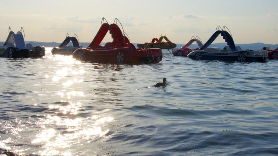 red and black kayak on sea during daytime