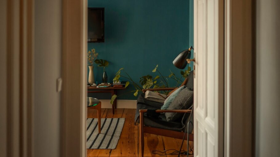 shallow focus photo of green plants on brown wooden table
