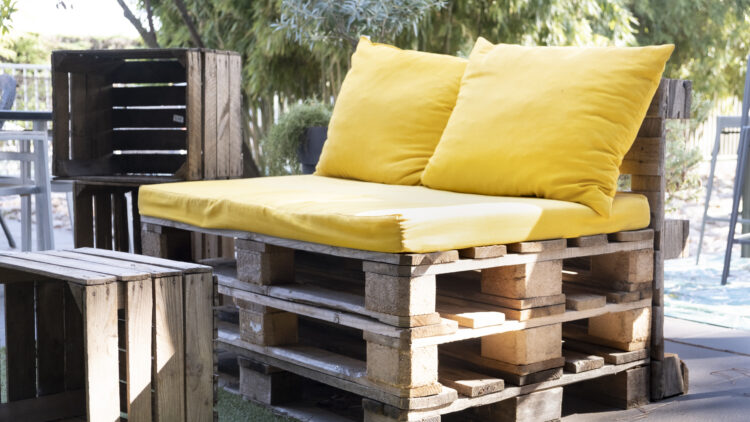 Upcycled outdoor seat made from pallets with wood crate as table