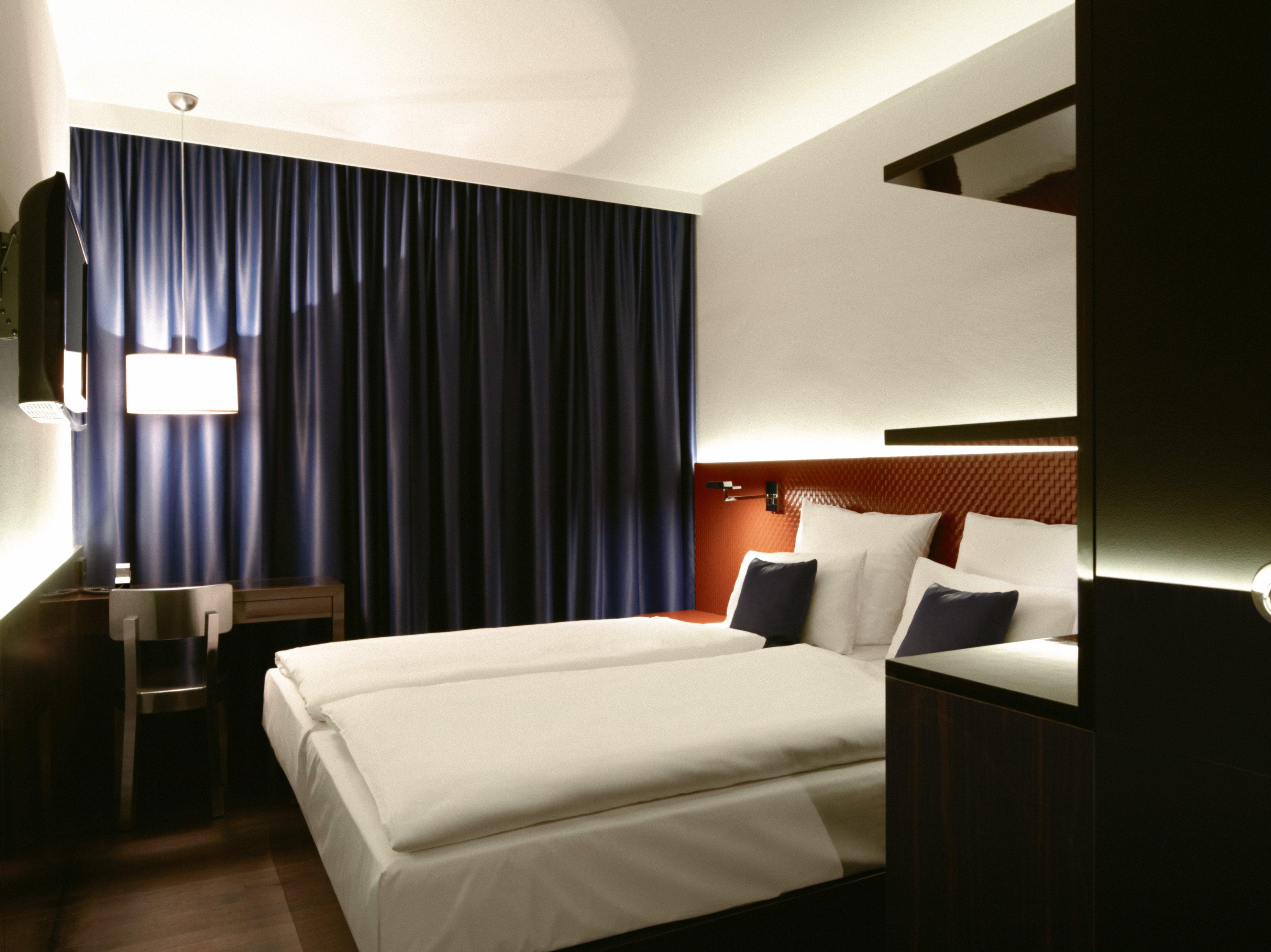 Die Doppelzimmer im Hotel MANI punkten modern-elegant.